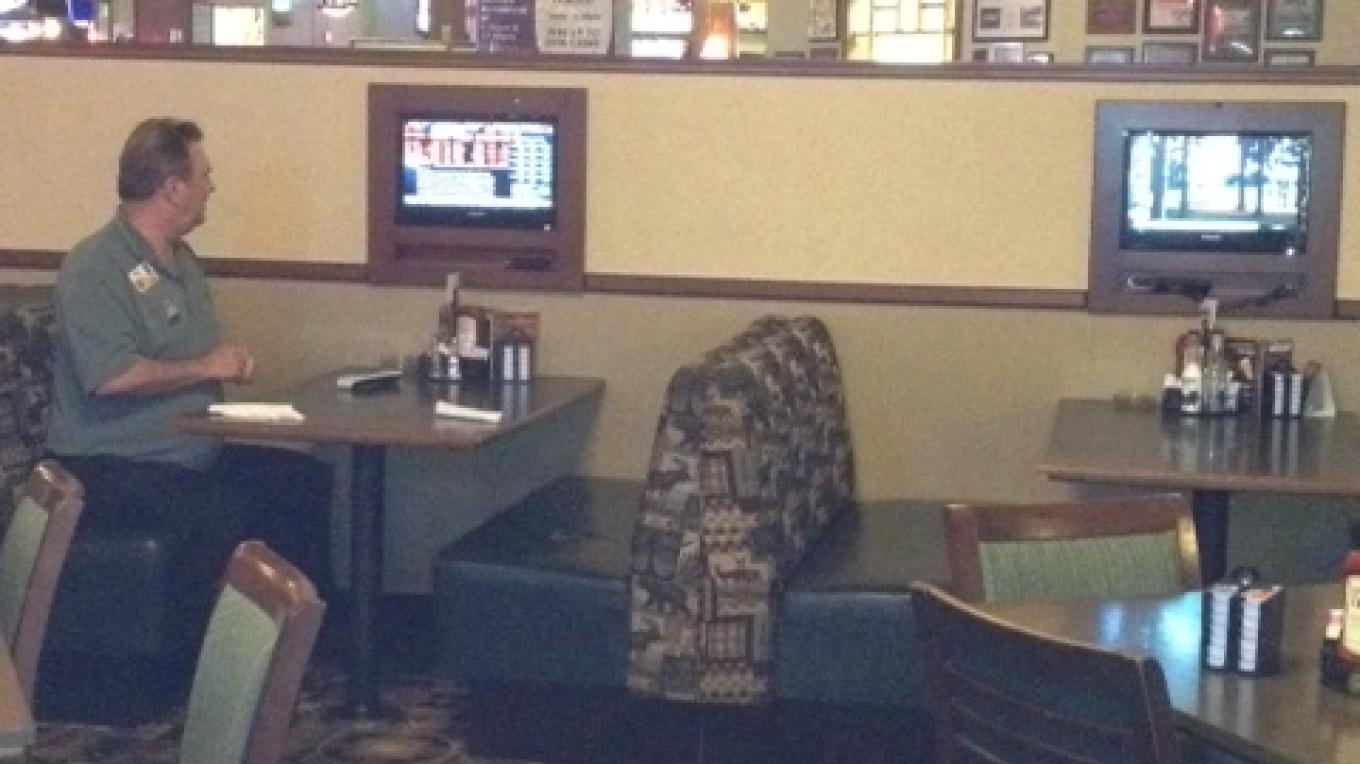 TVs in the non-smoking section of the Sports Bar and Grill. – Diamond Mountain Casino and Hotel