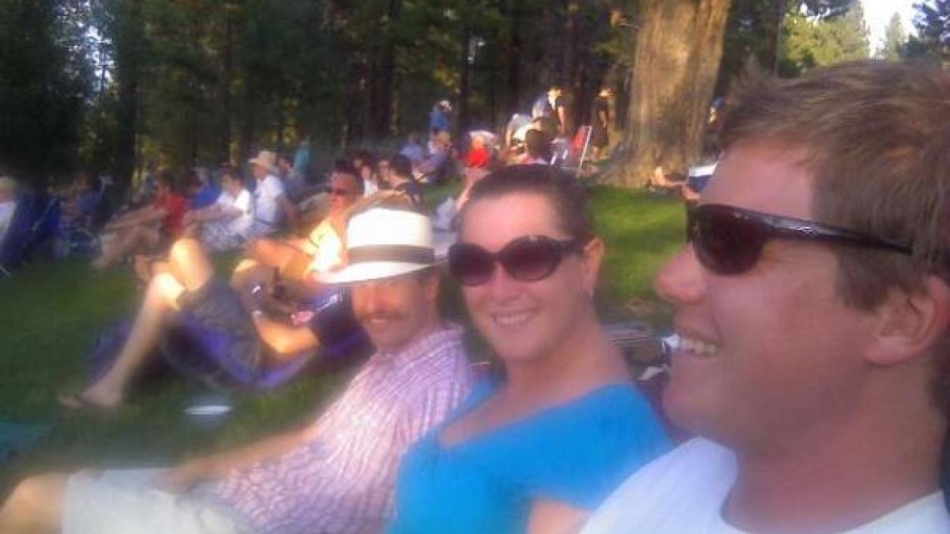 Music in the Park goers sitting in the lawn enjoying the music – courtesy of Switchback
