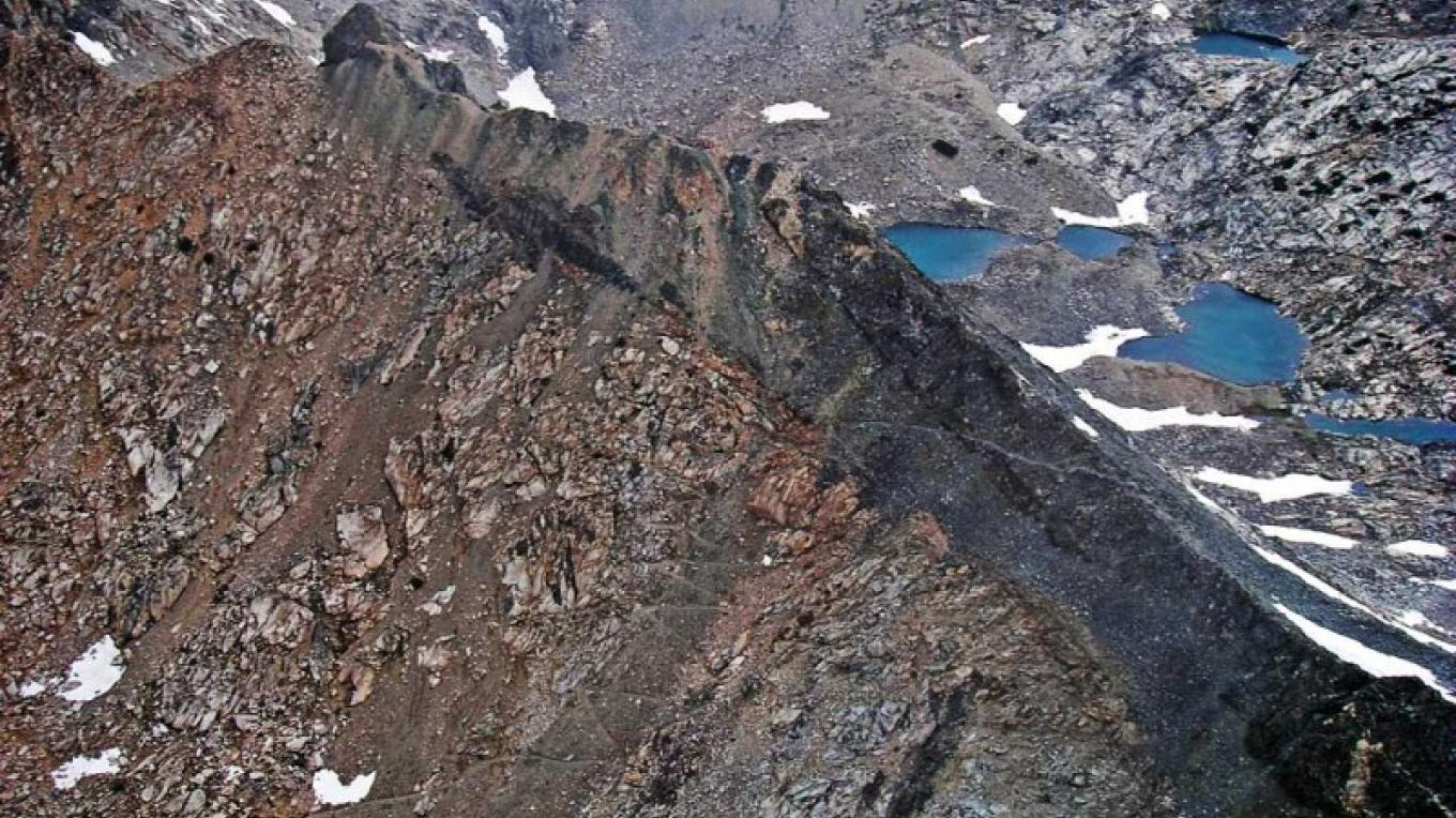 Aerial view of Glen Pass. You can see the trail switchbacking up the talus slope. – NPS