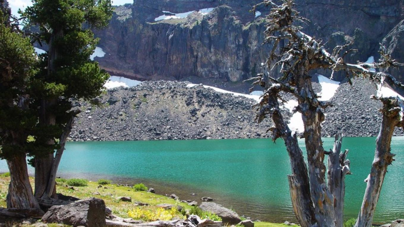 The cirque lake, Patterson Lake is a beautiful alpine glacier turquoise lake high in the Warner Mountains, with good fishing. – Jean Bilodeaux