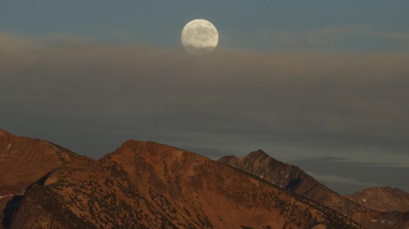 Full moon over the Sierra from Sentinel Dome – Jeanetta Phillips