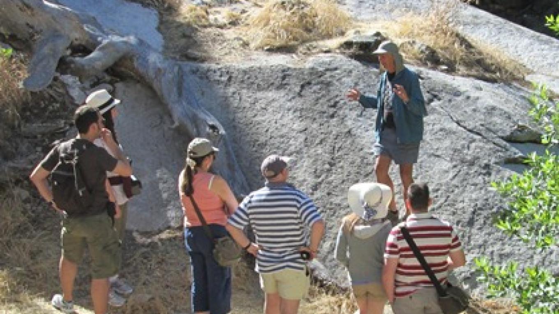 Guide demonstrates walking in balance at beginning of tour.