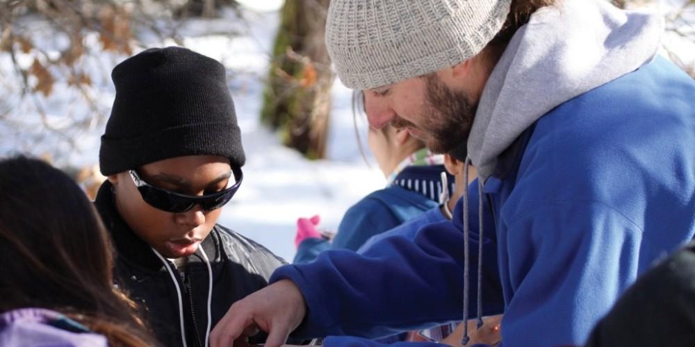 NatureBridge field science educator, Delaney Sharp with students.