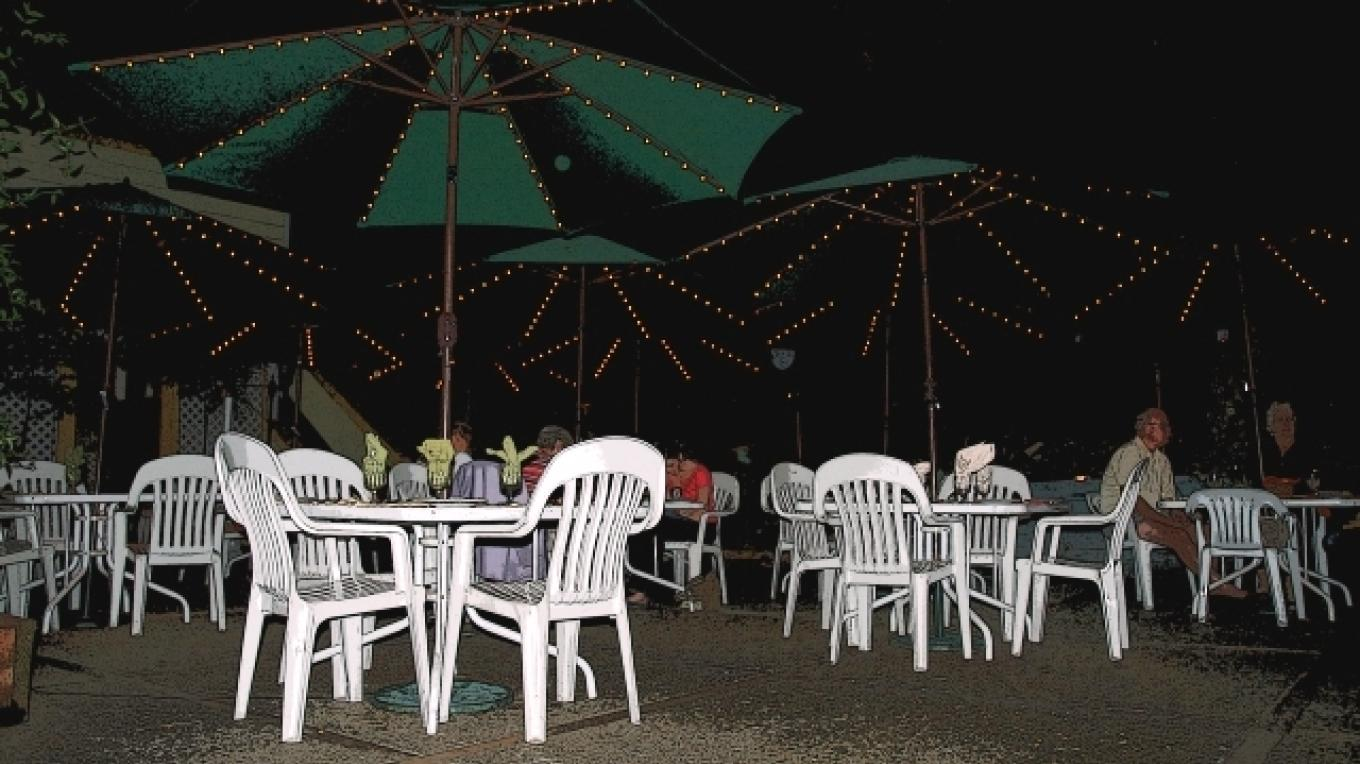 Evening Courtyard Dining with Lighted Umbrellas – Peggy Mosley