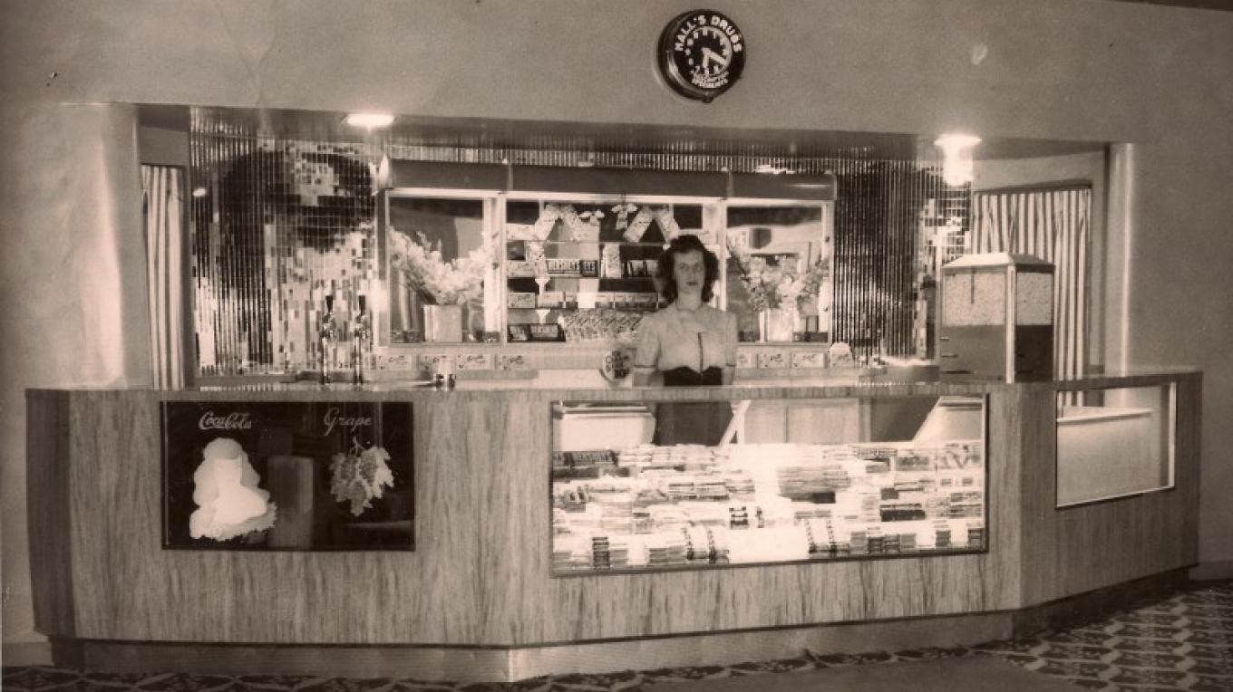 This 1944 photo of the partial lobby view and  concession counter of the State Theatre. – unknown