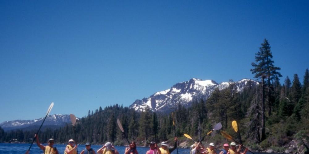 A flotilla cheers after a fantastic paddle adventure into  Emerald Bay. – B. Kingman