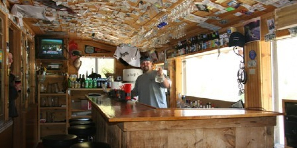 The bar at the Bishop Creek Lodge and Resort has a ceiling filled with interesting reading material. – Bishop Creek Lodge and Resort