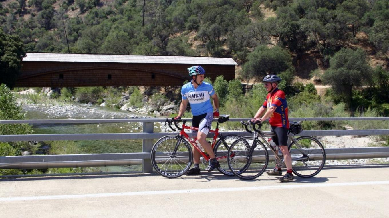 Cyclists at the historic covered bridge at Bridgeport, Nevada County, California – Dave Carter