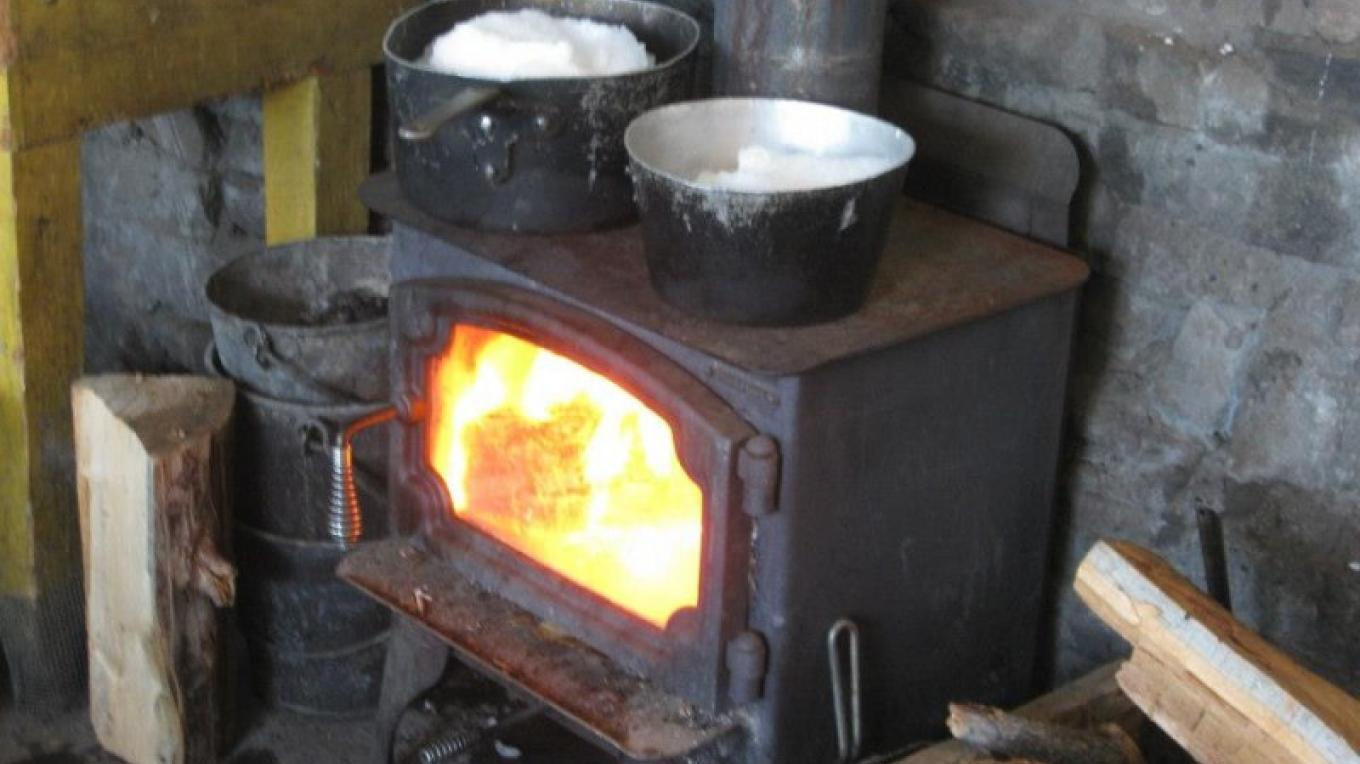 Melting snow over a toasty fire for drinking water. Please note there is no running water or sinks in the hut. – Steven Benesi