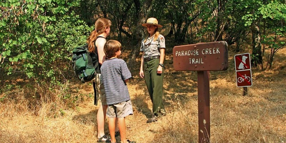 Paradise Creek trailhead is on the left side of the campground entrance in dense oak woodland. – NPS/Rick Cain