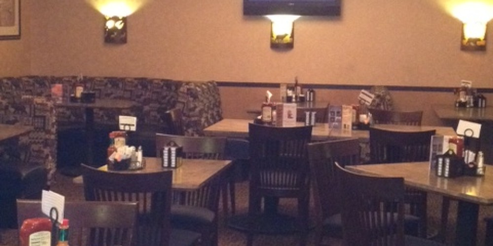 A TV at your booth in the Sports Bar and Grill. – Diamond Mountain Casino and Hotel