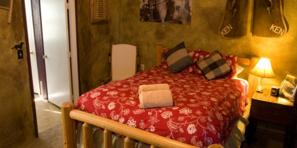 Buckaroo bed with Grandad Rose's chaps on the wall. – Curt Rose