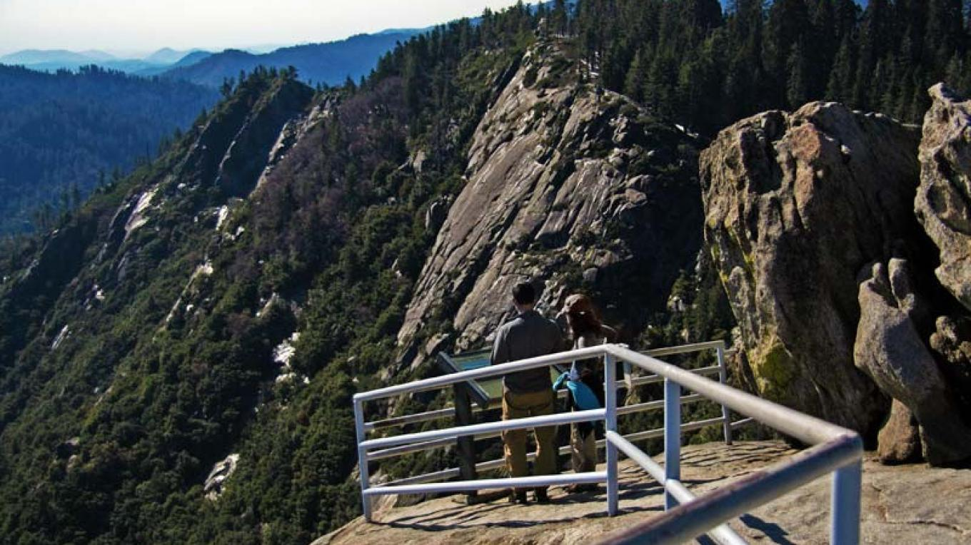 Visitors read an exhibit at the top of Moro Rock. – NPS/Rick Cain