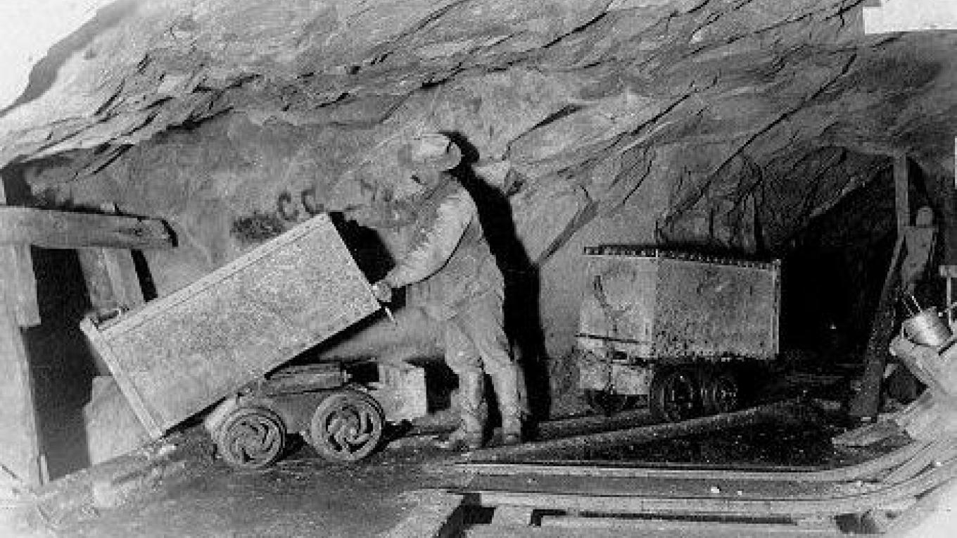 Workers in an underground mine – MiningArtifacts.org