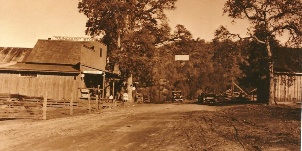 Auberry looking toward Rancheria Mountain Blacksmith on right store on left 1882              Auberry looking toward Rancheria Mountain 1882 – Unknown