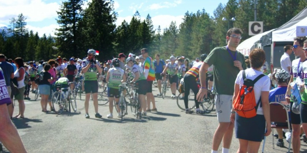 Bicyclists meeting up with their groups and making new friends in the finish area. – Bonnie L. MacRae