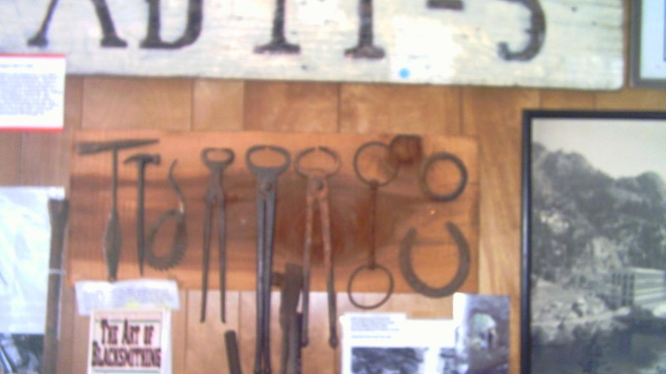Adit # 5 sign and blacksmith tools.