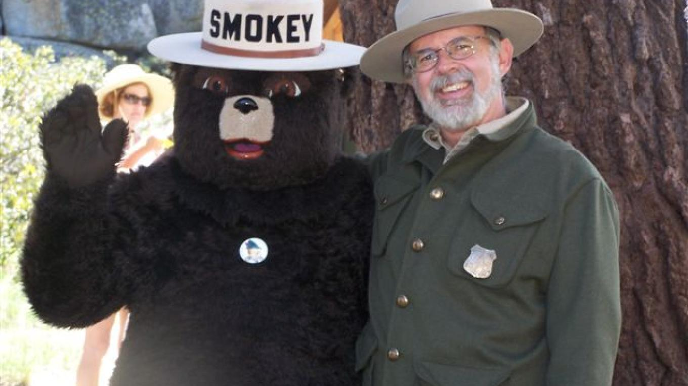 Old-time fire watcher poses with Smokey – Wendy Garton