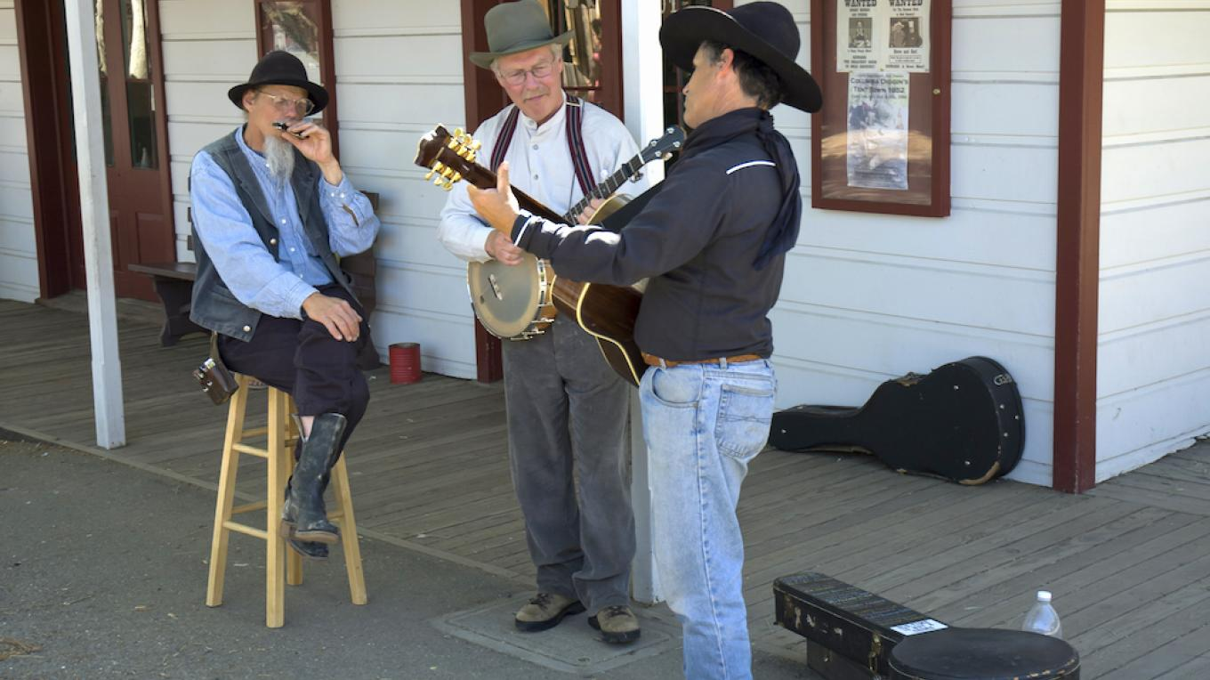 Old time musicians in the western gold mining town of Columbia, California. – Photo by Pierdelune / Dreamstime.com