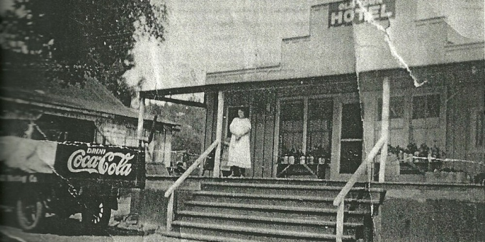 Hotel 1920's blacksmith shop to the left now Auberry Garage.  Note Coke brand marketing – Unknown