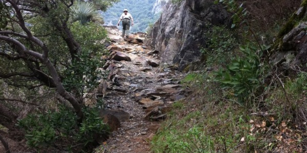 Steeper section of the Marble Fork Trail with ranger in early April – National Park Service