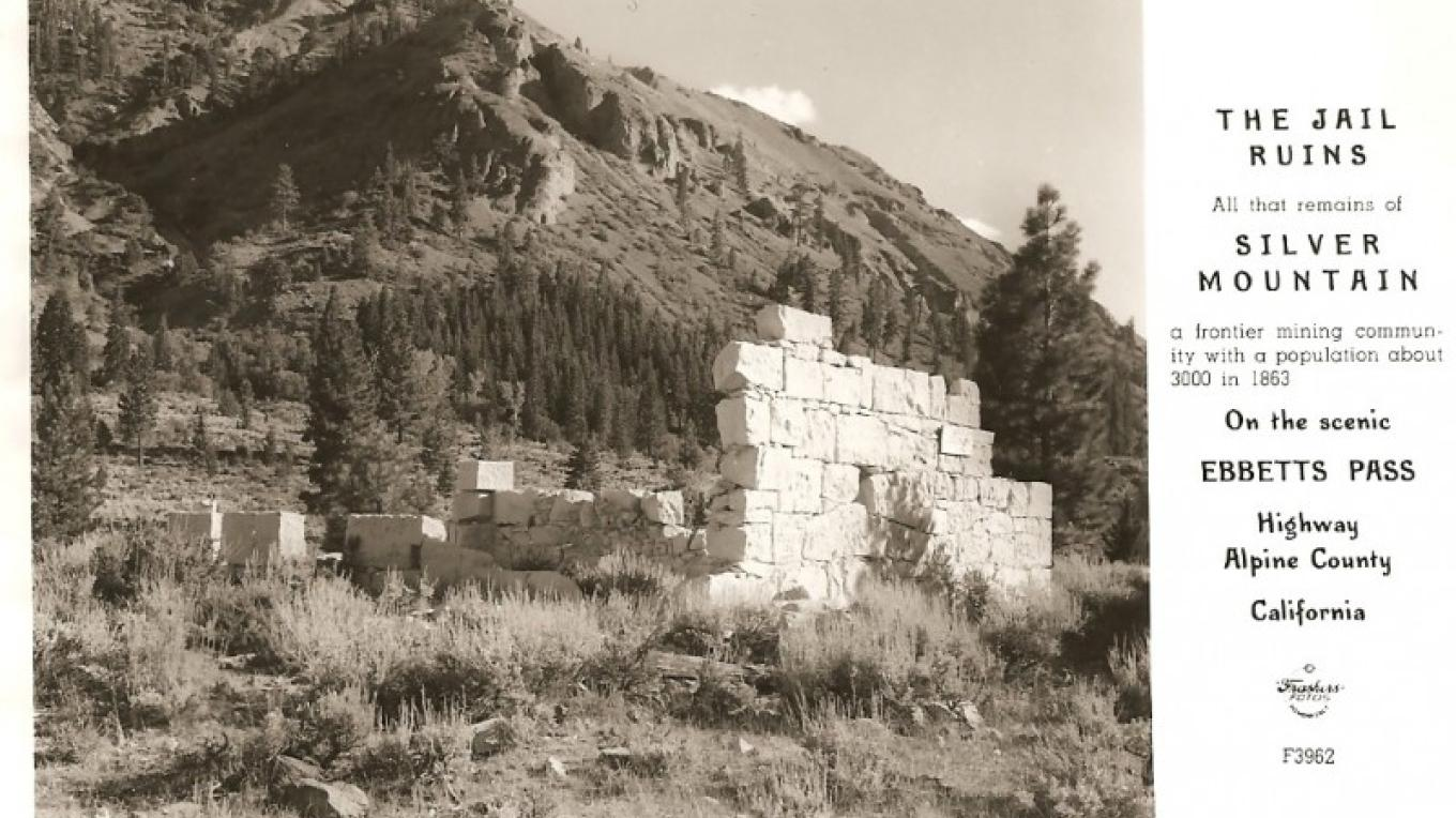 This vintage post card shows the remains of the Silver City Mountain jail, still visible outside of Markleeville. – www.HMdb.com