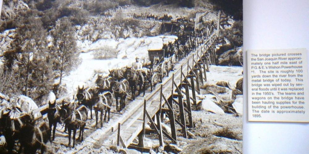 Original bridge at Kerckhoff  Powerhouse #2  with twenty mule team – Library photo by unknown