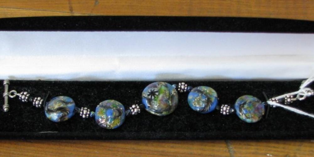 The color of the bracelet glass beads look like blue opal. – Karrie Lindsay