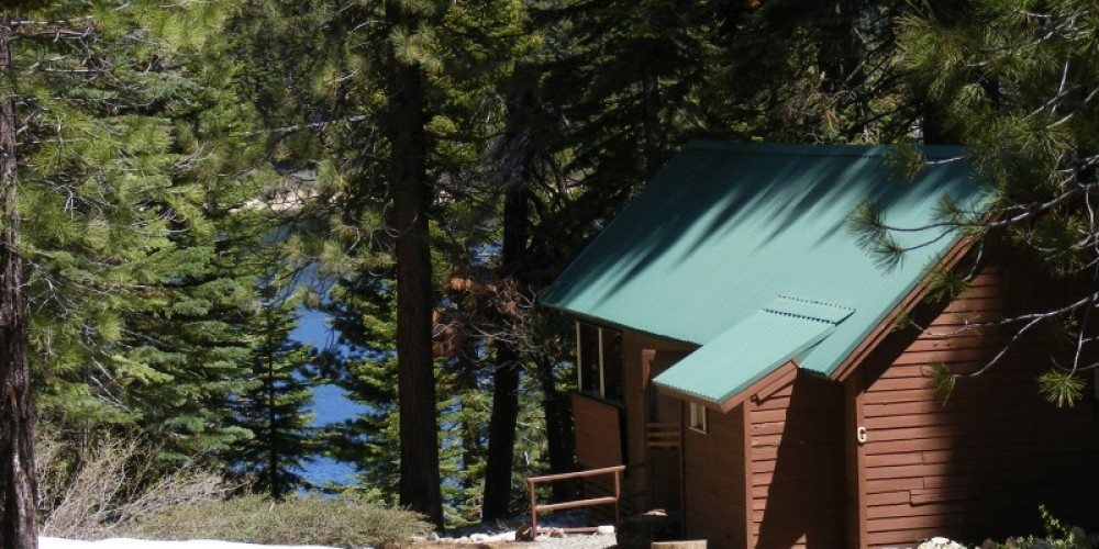 One of the cabins early in the season with a bit of snow. – Duane Ruth-Heffelbower