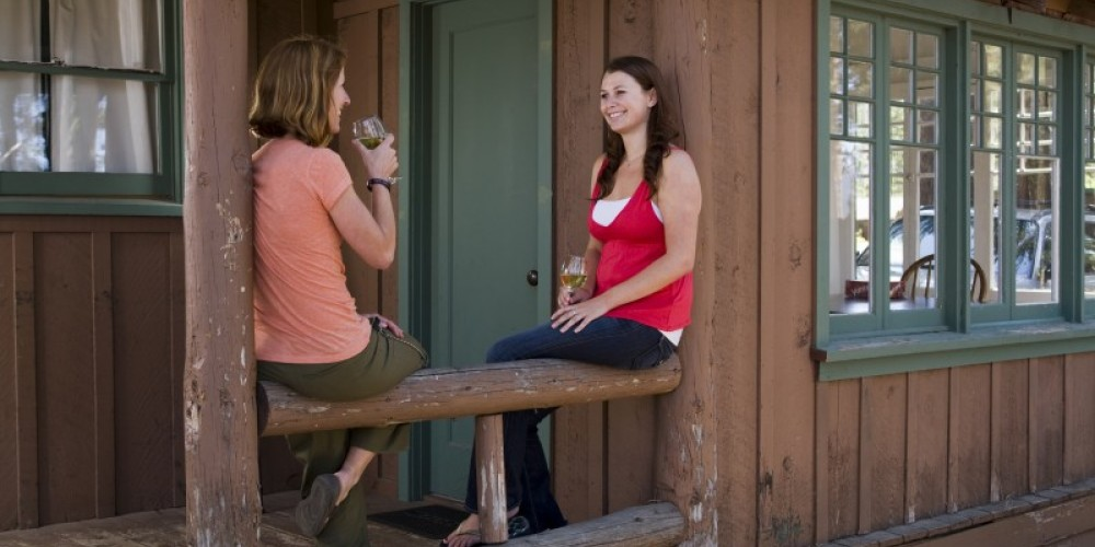 Sipping wine at Willy's Knight cabin in summer – Camp Richardson Resort