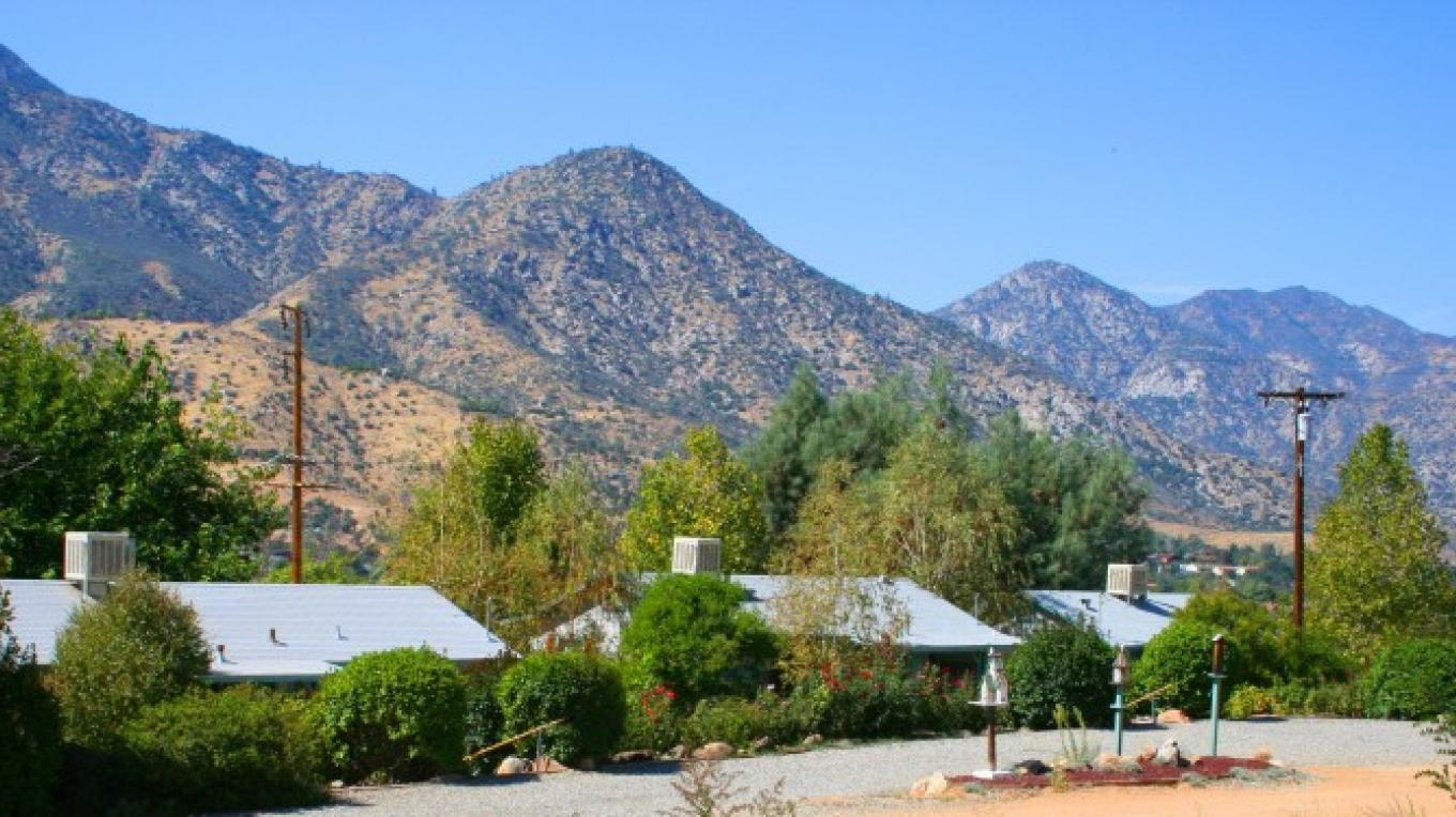 The three original Sierra Gateway Cottages as seen from the private parking area – Jon-Paul Fortunati