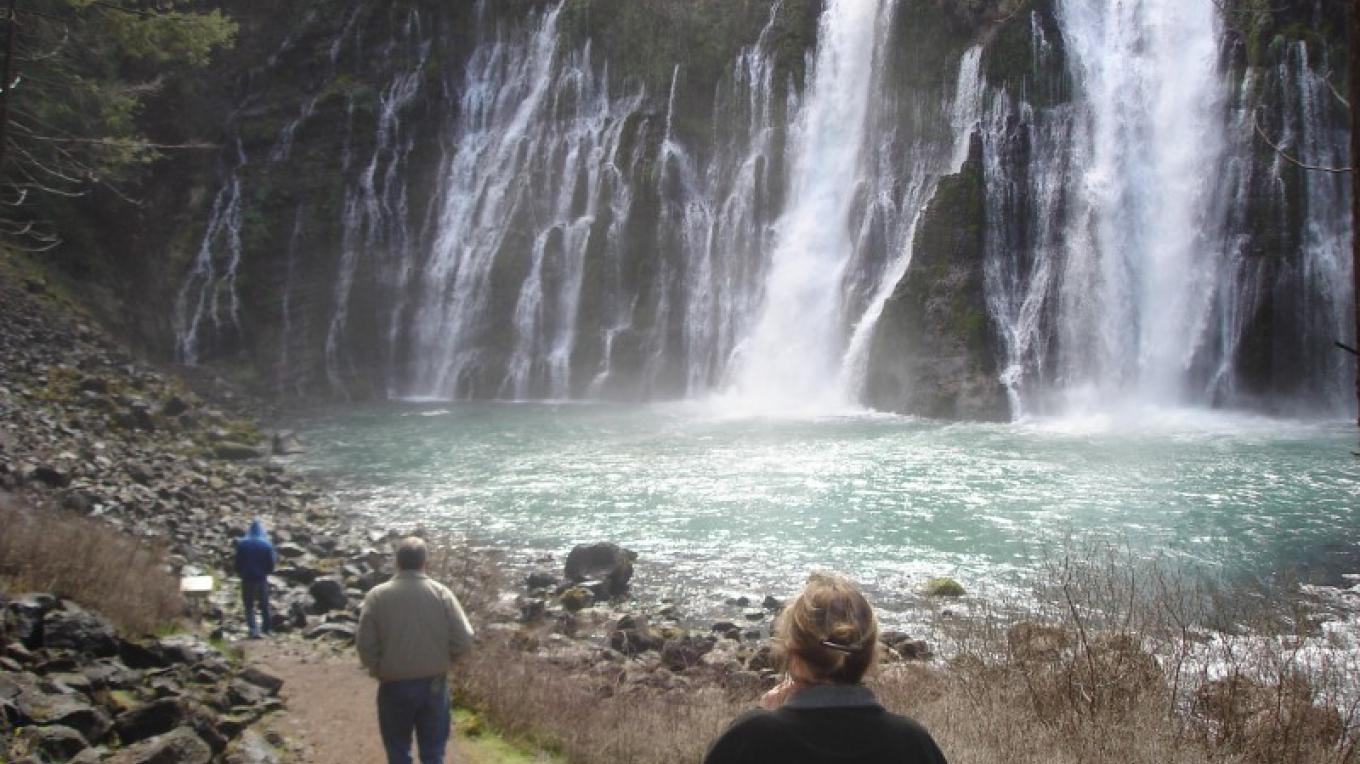Hikers approach the base of Burney Falls. – Ben Miles