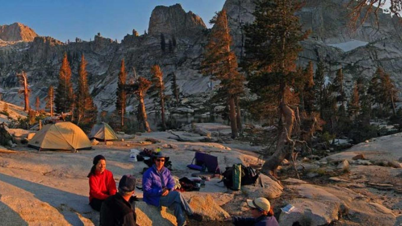 Campers share thoughts in the evening light near Pear Lake. – NPS/Rick Cain