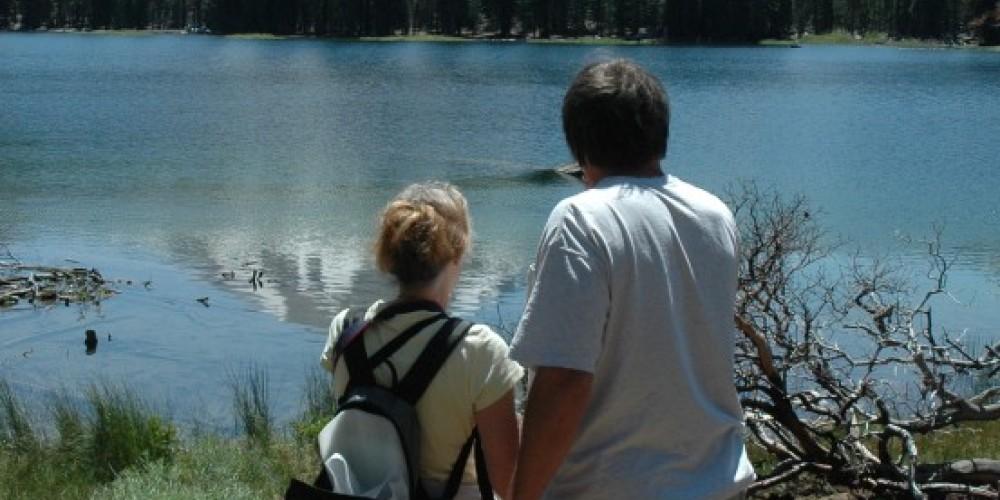 Hikers pause to enjoy the view of Lassen Peak above Manzanita Lake – Amanda Sweeney