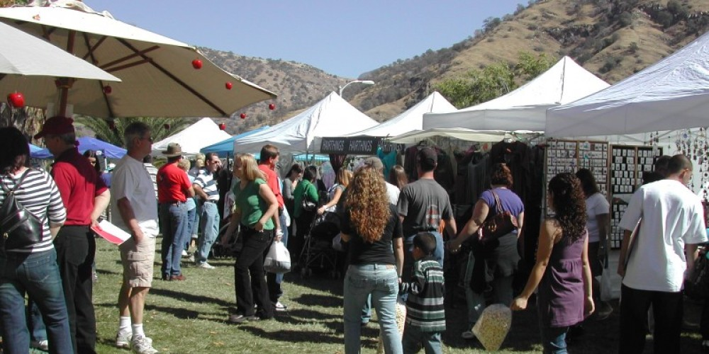 Visitors shop the 200 food, art and craft booths that a pop up in the village. – Marilyn Knesel