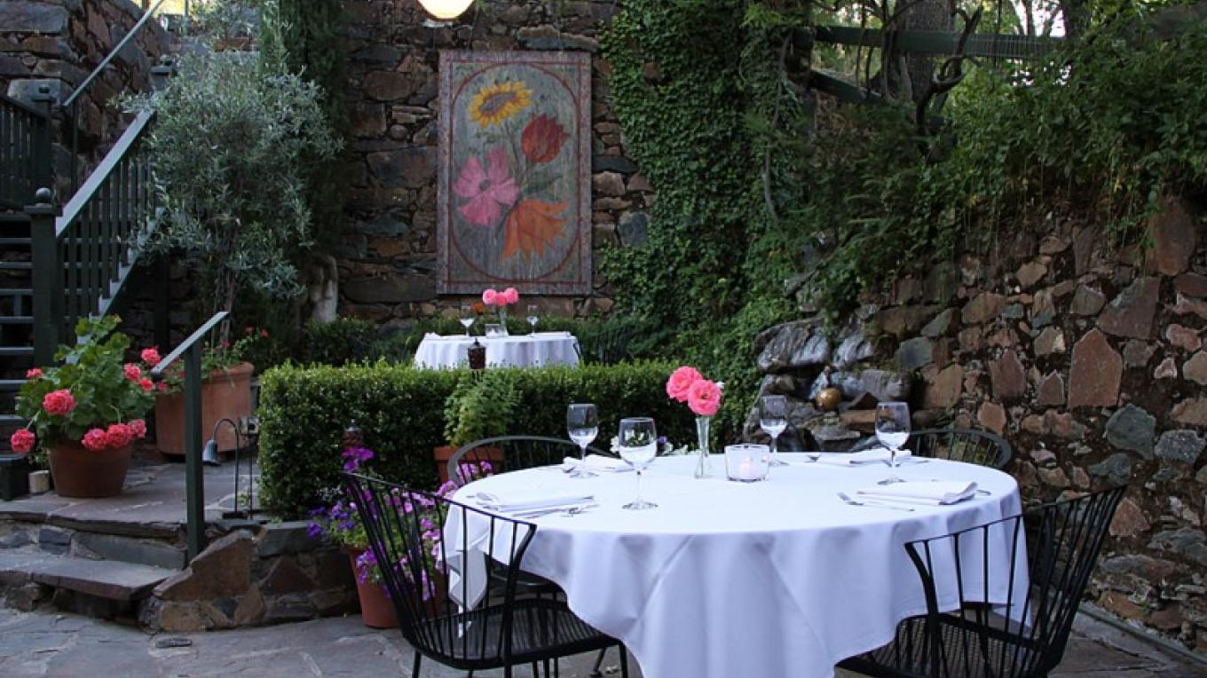 Imperial Hotel patio constructed with century-old native stones.  Outdoor dining available. – Christine Gustafson