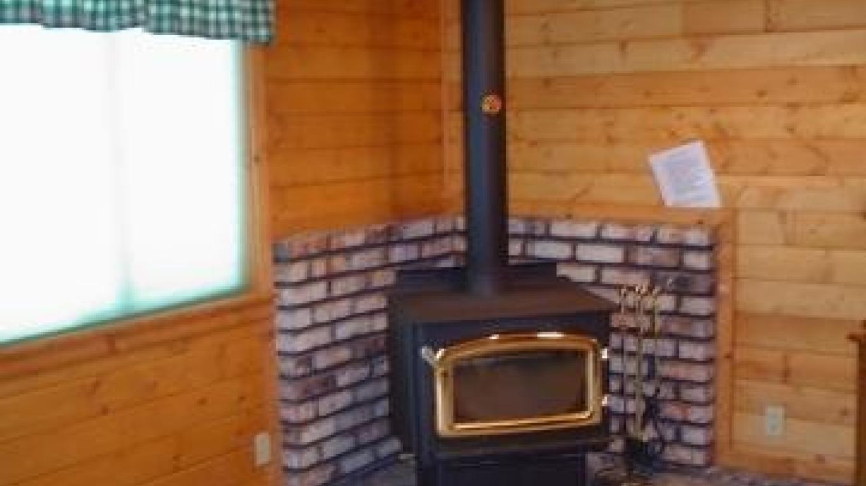 Sugar Pine Cabin has a cozy wood fire. – Jenine Haugh