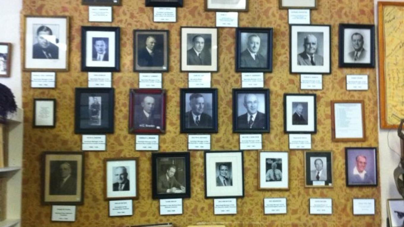 Old photos of McCloud River Lumber Executives in the McCloud Heritage Junction Museum. – by Allison Scull