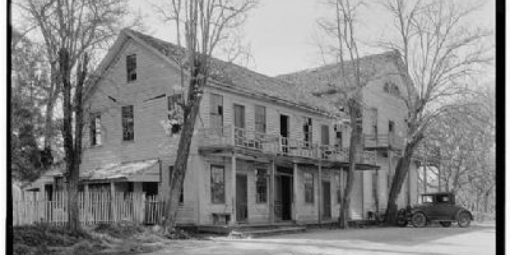 John Reddick House- the hotel was to the left and dining hall was to the right. The second story of the dining hall was later converted into a house and moved north. – Historical Markter Database