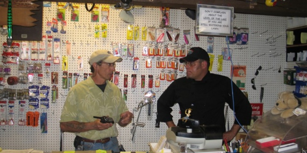 Jim and Dave discussing fishing (or food) in the store – Dave Wooley