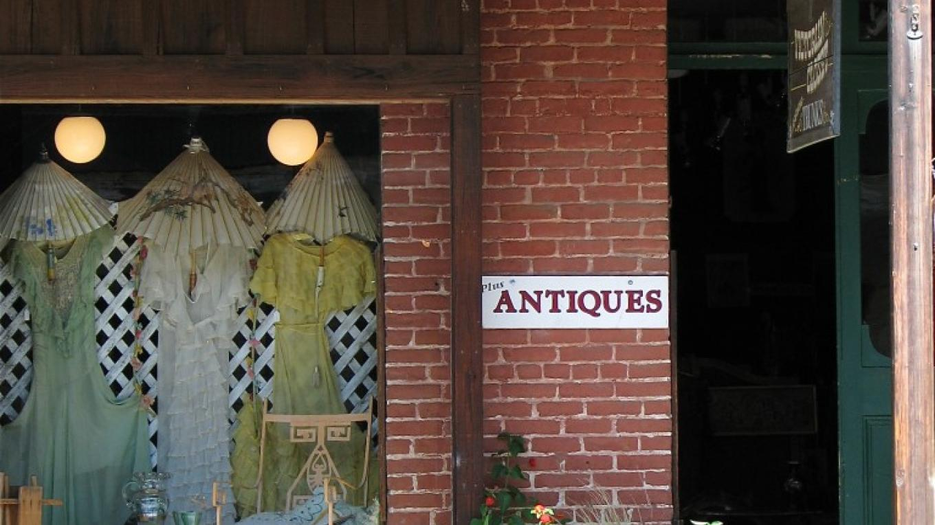 Sally Knudson's display windows are legendary and hint at what is in store for those who walk through the historic doors. Her store contains a huge collection from the 1860s through the 1930s. – Karrie Lindsay