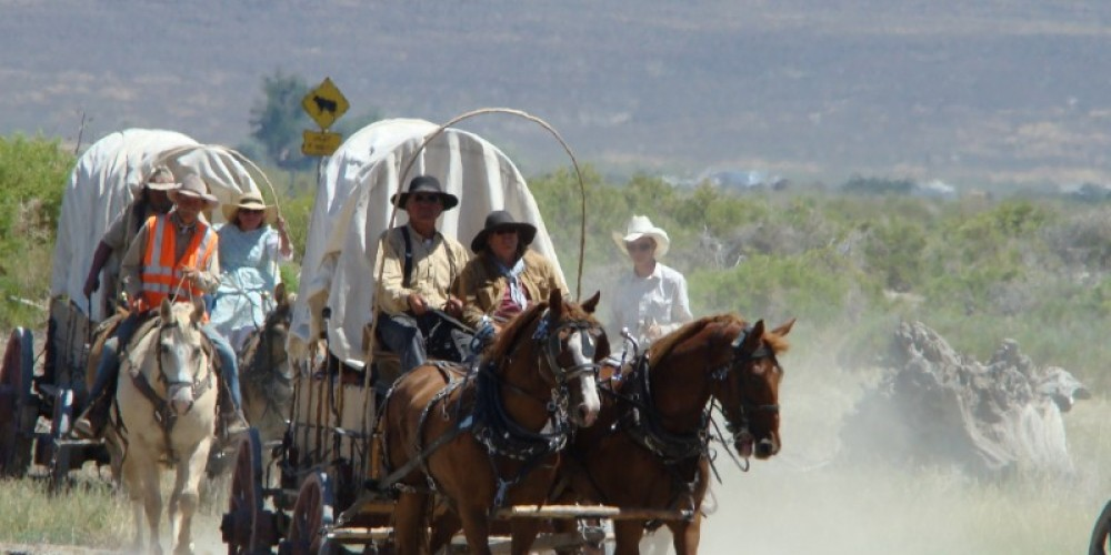 Reinactors have come in their covered wagons from Winnemucca to Surprise Valley on the Applegate Trail. Shown here crossing the playa into Cedarville. – Jean Bilodeaux