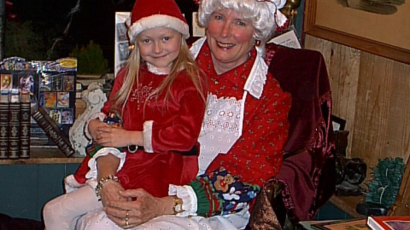 MRS. CLAUS AND ONE OF THE KIDS. – LINDA HEIN