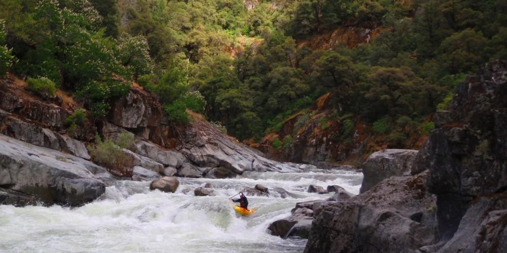 Kayakers in the North Fork Mokelumne Devil\'s Nose reach. – Daniel Brasuell