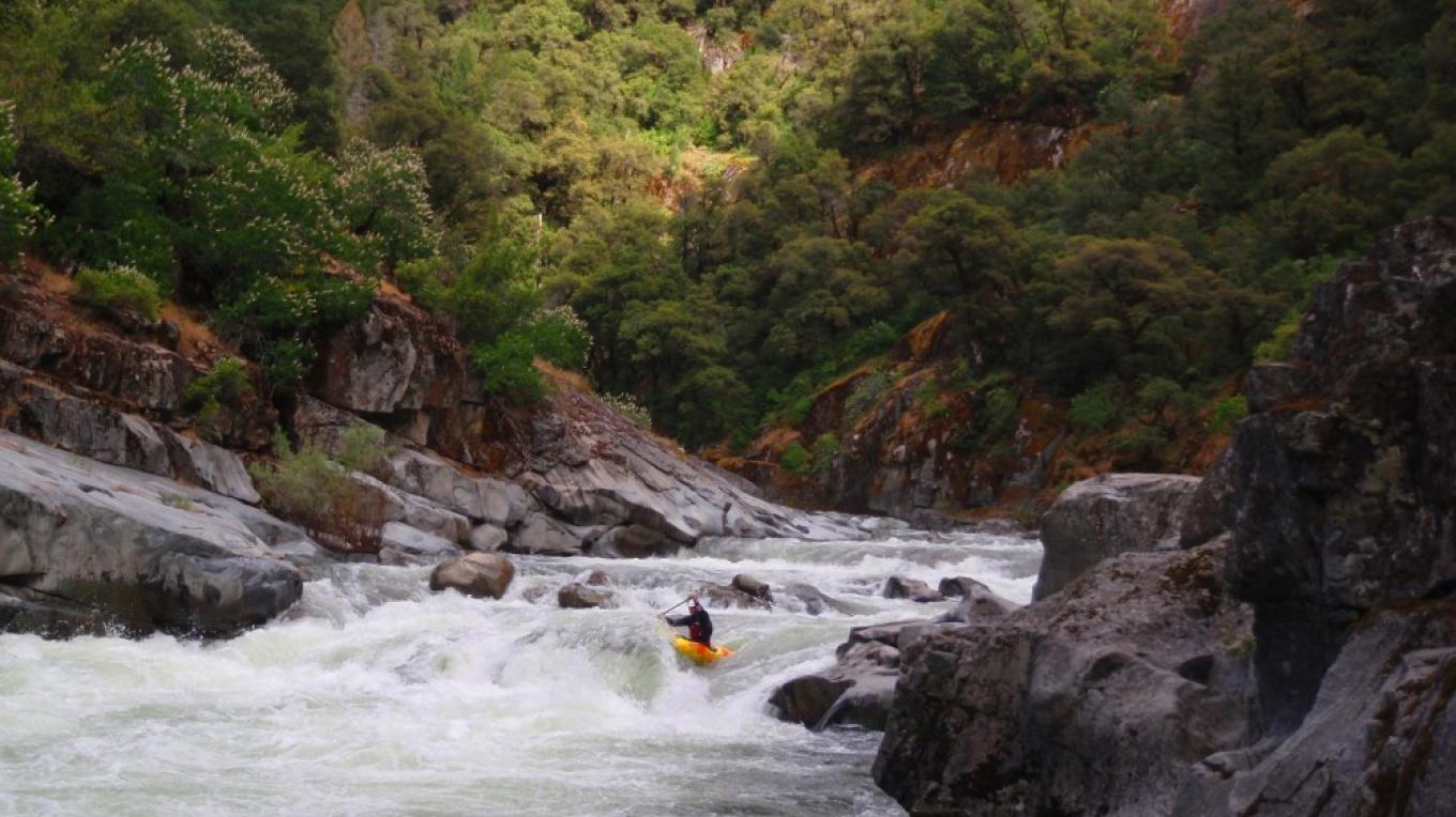 Kayakers in the North Fork Mokelumne Devil\'s Nose reach. – Daniel Brasuell