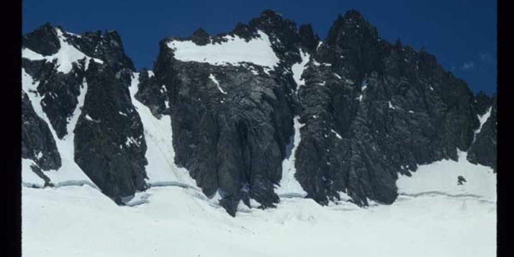 North Palisade Peak (14,242\', 4341m) and the U Notch Couloir rise high above the Palisade Glacier, the southern most glacier in the lower 48 states. – Kurt Wedberg