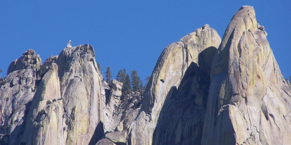 Zoomed in shot of the Needles. Note the fire lookout tower.  This is one huge rock! – Frank Brassell