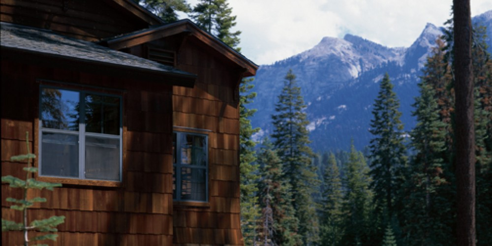 Exterior of one of our three lodging buildings with mountain view
