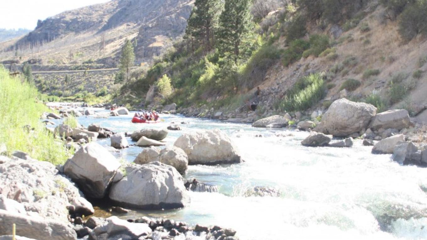 A raft approaching the Floriston Gorge Class 3 rapids on the Lower Truckee River – www.truckeeriverphotos.com