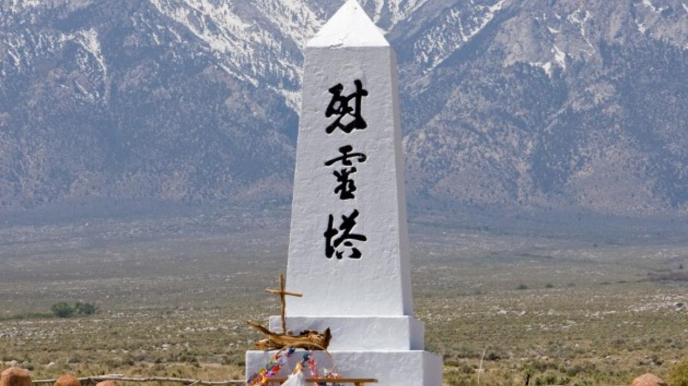 "The ""Soul Consoling Tower\"" in the Manzanar cemetery stands as a towering reminder of the \""internment\""of Japanese Americans in the Manzanar \""relocation camp.\"""